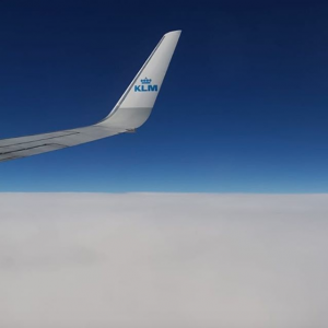 Creative Globetrotter Flying above the clouds
