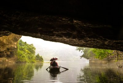 With a boat over the river in Ninh Binh